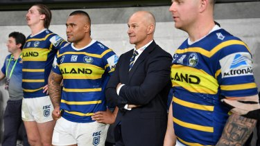 Brad Arthur takes in the atmosphere on the touchline towards the end of the match.