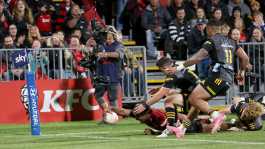 Sevu Reece reaches out to give the Crusaders the advantage at Orangetheory Stadium.