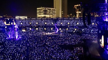 Wristbands adorned by Swift's fans light up the Gabba.