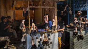 Muslims selling meat wait for customers in Lucknow, Uttar Pradesh, India.