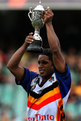 Preston Campbell holds up the trophy after the Indigenous side beat the New Zealand Maoris in the curtain-raiser to the opening game of the 2008 Rugby League World Cup.