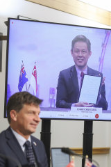 Singapore Minister for Trade and Industry Chan Chun Sing (seen on screen) speaks to Energy Minister Angus Taylor in October 2020.