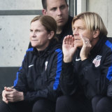 Tony Gustavsson in the dugout with USA coach Jill Ellis.