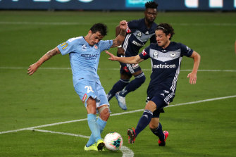 Marco Rojas, right, and Melbourne City's Adrian Luna, left, vie for possession in their round 18 derby clash.