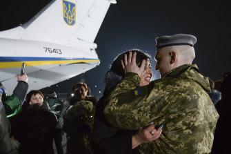 Yulia embraces her husband Olexander Korinkov, a Ukrainian soldier and prisoner of war released after a prisoner exchange, at Boryspil airport outside Kiev, Ukraine.