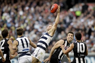 Cats ruckman Brad Ottens attempts to control a bounce at a stoppage.