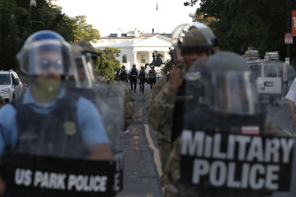 US Park Police and Military Police  clear the area around Lafayette Park.