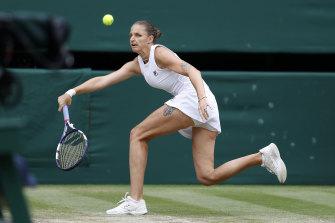 Karolina Pliskova chases down a shot from Ashleigh Barty.