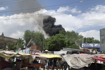 Smokes rises from a hospital after an attack by militants in Kabul, Afghanistan.