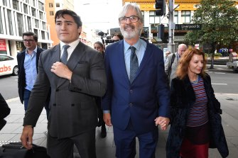 Jarratt leaves court in Sydney in July with wife Rosa Miano.