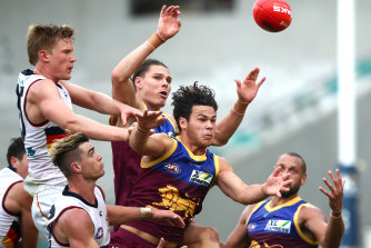 Cam Rayner of the Lions (center) competes for the ball against Adelaide in round 4.