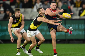 Steven May gets a kick away against the Tigers.