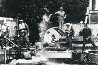 A HEC bulldozer driver uses a high-pressure hose on anti-dam protesters at Warners Landing.