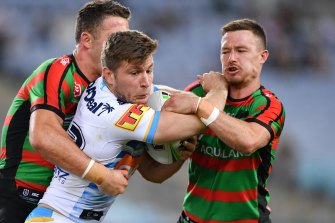Jai Arrow could be playing alongside Souths' Damien Cook (right) next year instead of against him.