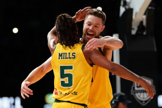 Patty Mills and Andrew Dellavedova celebrate Australia's shock win over the USA.