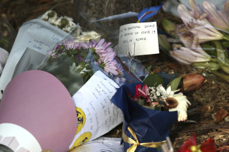 Flowers and tributes outside Newmarch House, where more than a dozen residents died from COVID-19.