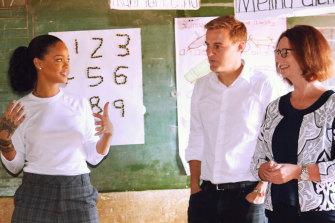Julia Gillard in a Malawi classroom with Rihanna and Global Citizen's Hugh Evans.
