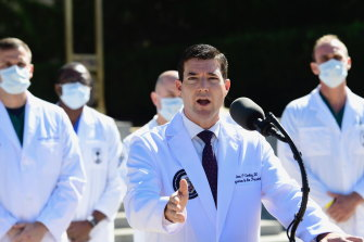Dr Sean Conley, White House physician, speaks at a press conference outside of Walter Reed National Military Medical Center in Bethesda, Maryland, US, on Saturday, October 3, 2020.