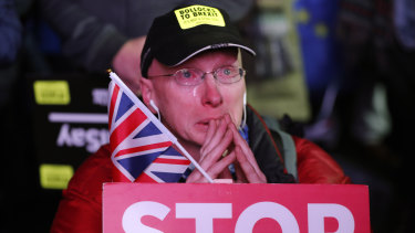An anti-Brexit demonstrator cries as he gathers in Parliament Square in London.