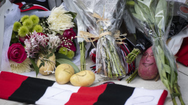 """Fans have laid tributes, including potatoes, for Danny """"Spud"""" Frawley."""