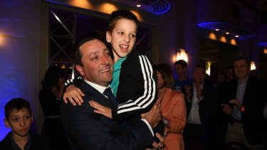 Matthew Guy with his son at the Liberal Party campaign launch.