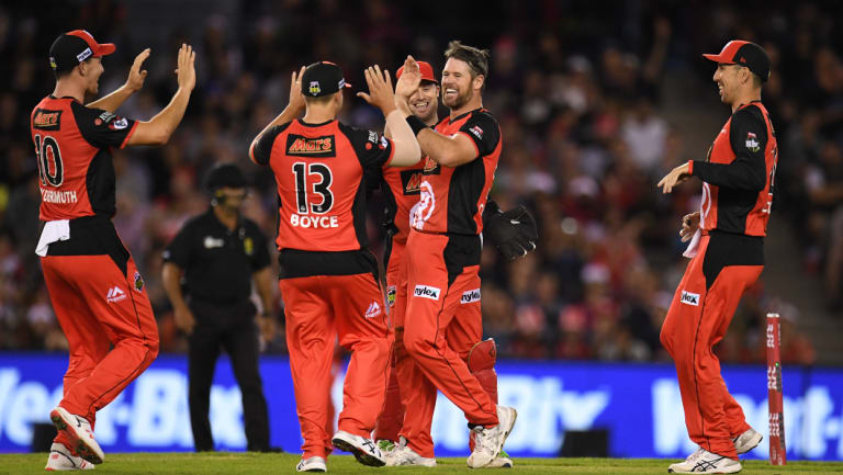 Daniel Christian of the Renegades, second from right, reacts after dismissing Michael Klinger of the Scorchers.