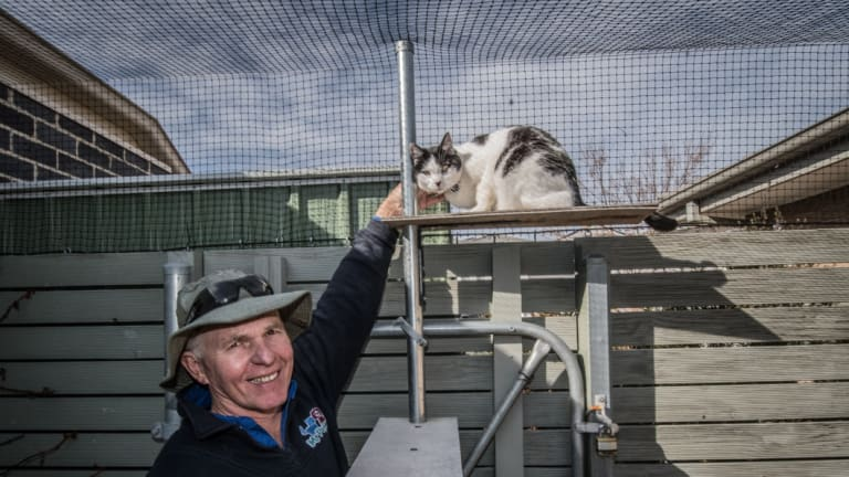 Thomas Graham, who helps install cat containment spaces around Canberra.