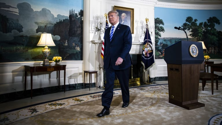 Donald Trump exits after speaking about the US exit from the Iran deal.