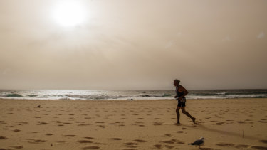 Dust clouds the sky over Maroubra on Wednesday.