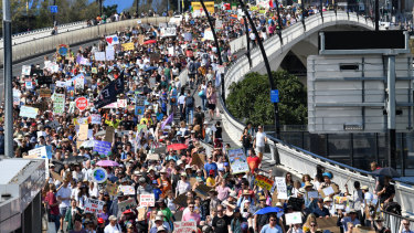 Organisers estimated more than 30,000 people marched across Victoria Bridge from Brisbane's CBD to South Brisbane on Friday.