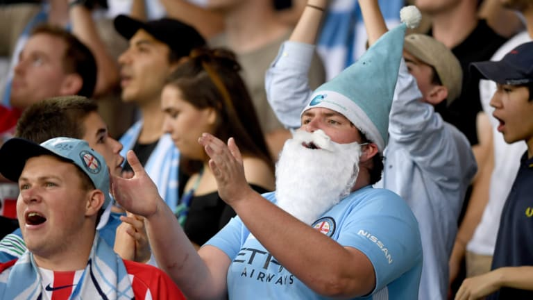 Christmas cheer: A Melbourne City supporter shares the spirit last year.