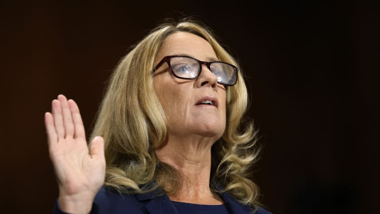 Christine Blasey Ford is sworn in before recounting her allegation of sexual assault to the Senate Judiciary Committee.