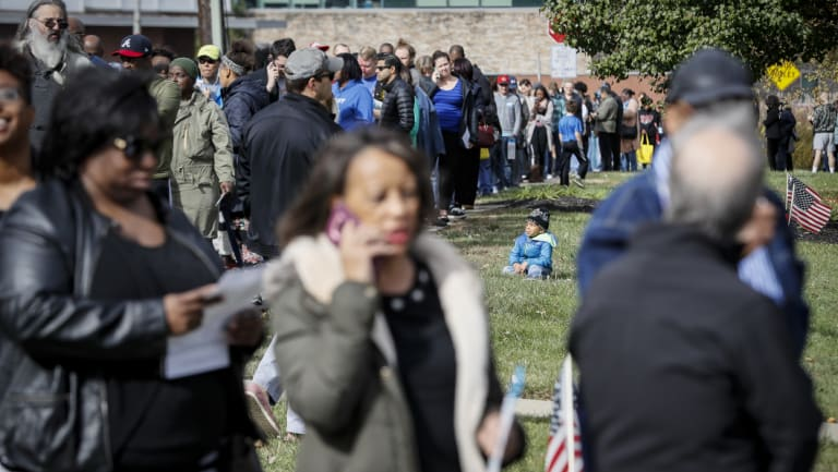 A line forms for early voting in Cincinnati on Sunday..