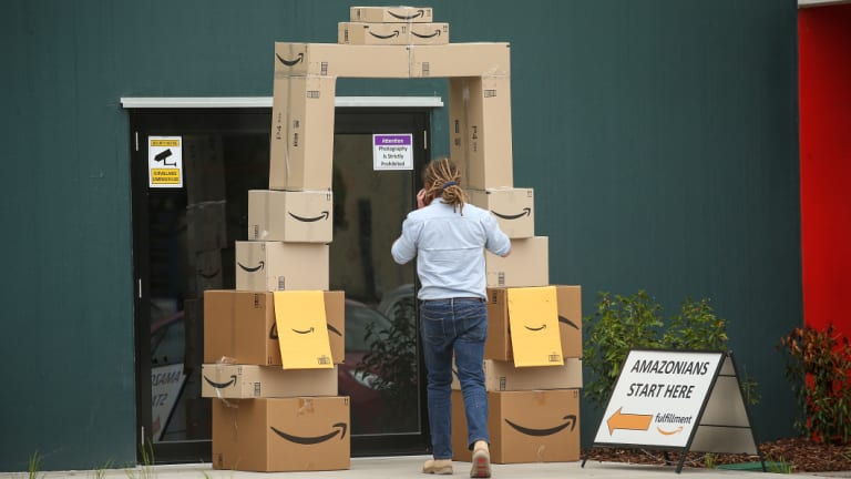 An employee enters Amazon's Melbourne warehouse on the day its local website went live.