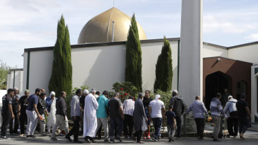 Worshippers prepare to enter the Al Noor mosque following last week's mass shooting in Christchurch, New Zealand, on Saturday.