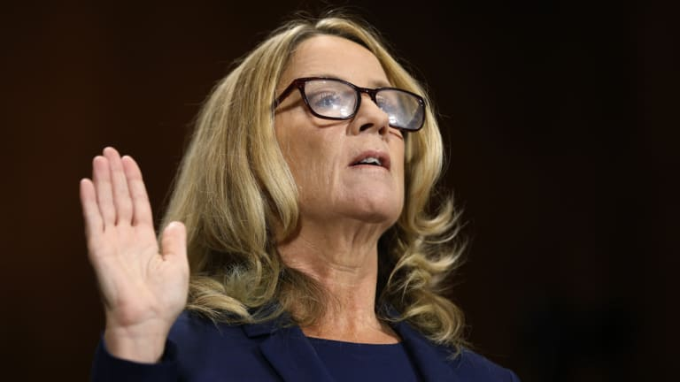 Christine Blasey Ford is sworn in before recounting her allegation of sexual assault to the Senate Judiciary Committee,