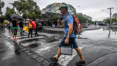 Umbrellas were the accessory of choice across the state on Thursday.