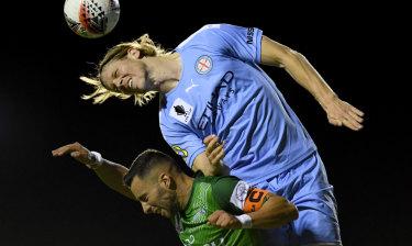 Harrison Delbridge of City beats Marconi's Marko Jesic to a header on Wednesday night.