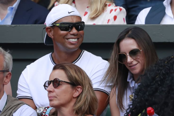 Tiger Woods sits in Williams' player box during this year's Wimbledon singles final.