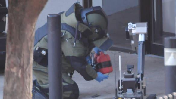 Police hunt man filmed leaving 'fake bomb' in Frankston court doorway
