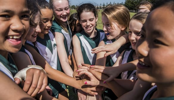 AFL girls kicking goals in rugby league territory