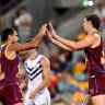 BRISBANE, AUSTRALIA - MAY 09: Joe Daniher of the Lions celebrates with Callum Ah Chee after kicking a goal during the round eight AFL match between the Fremantle Dockers and the Brisbane Lions at The Gabba on May 09, 2021 in Brisbane, Australia. (Photo by Bradley Kanaris/AFL Photos/via Getty Images)