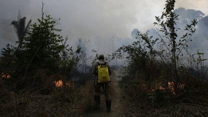 Spurning Amazon aid, Bolsonaro demands apology from Macron