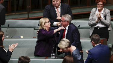 Wayne Swan is congratulated by Jenny Macklin, who is also retiring from politics.