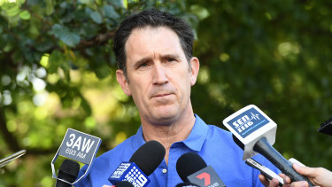 Facing the music: Cricket Australia chief James Sutherland fronts the media to address the ball-tampering scandal.