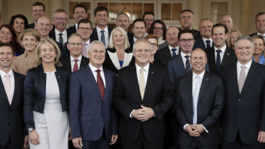 Prime Minister Scott Morrison with his new-look ministry after the swearing-in ceremony.