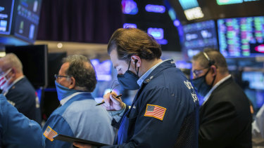 Traders on the floor of the New York Stock Exchange. There's concerns the market has climbed too high and left share prices too expensive.