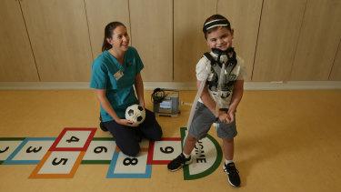 Physiotherapist Meg Lombard and Kobe in the John Hunter Hospital.