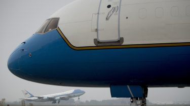 Secretary of State Mike Pompeo's plane in the foreground, and Trump's Air Force One behind, take off from Hanoi after the unsuccessful summit.