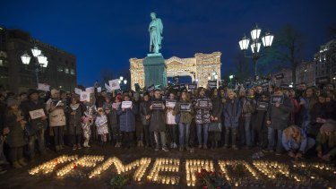 People commemorate the victims of Sunday's fire in a shopping mall in Kemerovo, Siberia, in Moscow on Tuesday.